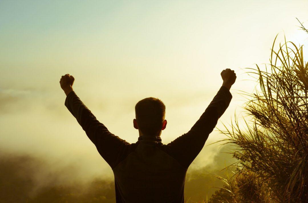 Man raising hands in air silhouette