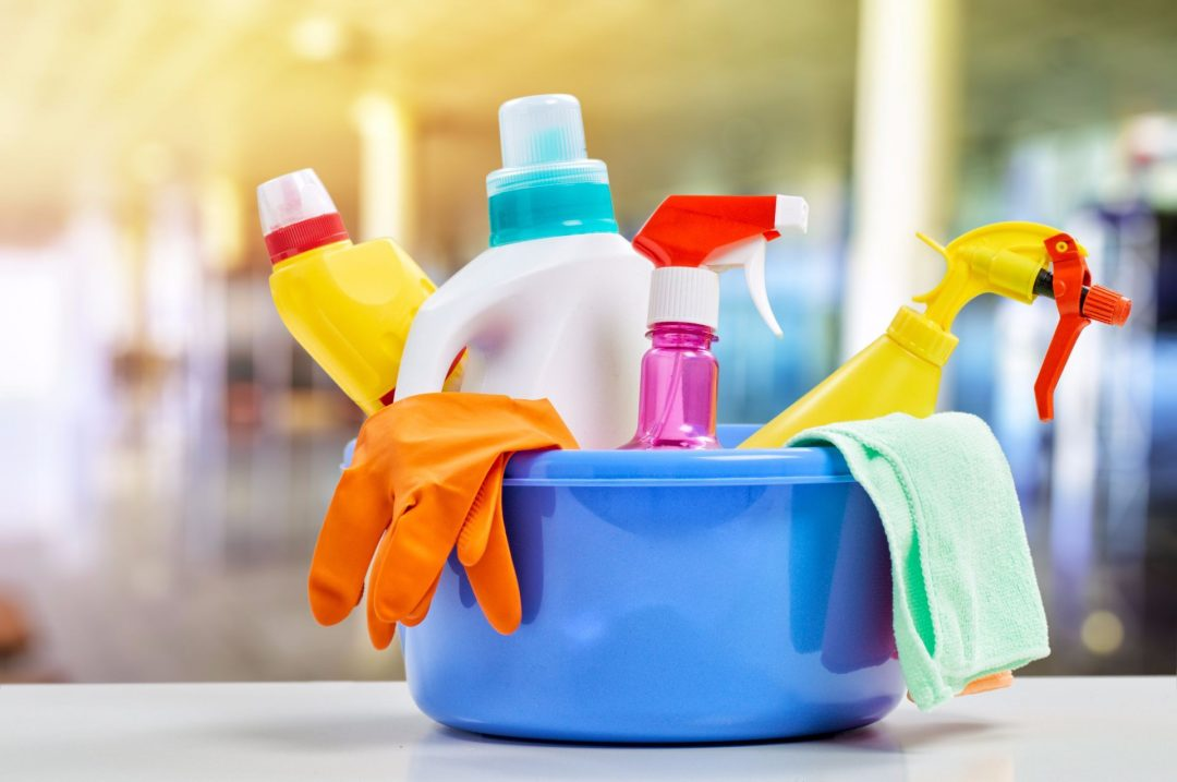 Colourful cleaning supplies in a bucket