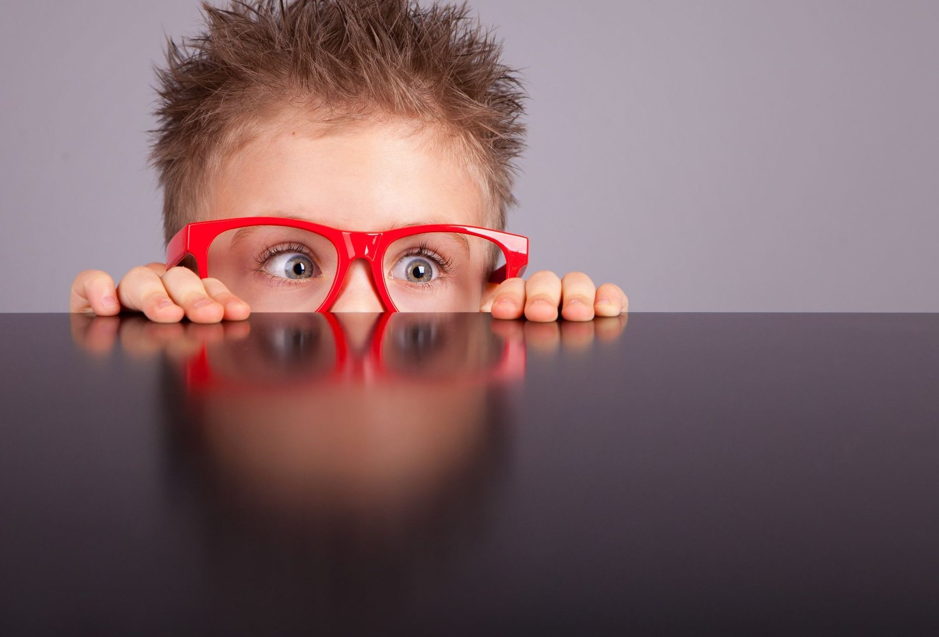 10 Tips for Making Your Blog Post Easier to Read | Edublogs |Boy with glasses peeking over bench