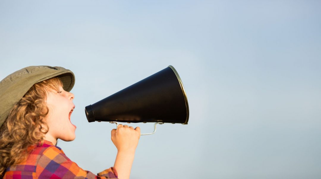 How to use quotes in blog posts | The Edublogger | Child talking through megaphone