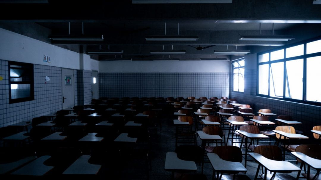 A dark and empty classroom.